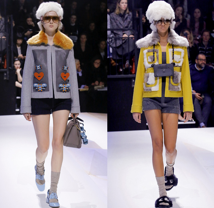 Anya Hindmarch 2017-2018 Fall Autumn Winter Womens Runway Catwalk Looks - London Fashion Week Collections UK United Kingdom - Old Norse Folklore Scandinavian Kurbits Wool Felt Outerwear Coat Poncho Cloak Cape Jacket Turtleneck Chunky Fairisle Knit Sweater Embellishments Adorned Decorated Bedazzled Hearts Dragonflies Leaves Combishorts Romper Onesie Playsuit Stack Collection Handmade Paper Chains Leather Straps Bag Mountain Smiley Slides Shearling Creepers Eyes Clogs Mules Sandals With Socks Sunglasses Shades Ear Muffs Hotpants Diaper Shorts Tote