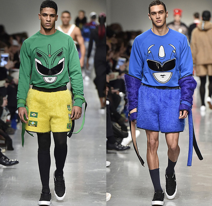 Bobby Abley 2017-2018 Fall Autumn Winter Mens Runway Catwalk Looks - London Collections Fashion Week Mens British Fashion Council UK United Kingdom - Power Rangers Dinosaurs Teddy Bear Pop Art Knit Sweater Jumper Furry Shaggy Shearling Mohair Shorts Over Leggings Straps Arm Warmers Sweatpants Jogger Colorblock Tracksuit Outerwear Coat Crop Top Midriff Leg Panels Poncho Cloak Trucker Jacket Harness Trainers Shoes Choker Helmet Tote Bag Denim Jeans