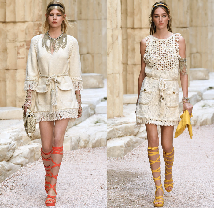 Chanel 2018 Resort Cruise Pre-Spring Womens Runway Catwalk Looks Collection Karl Lagerfeld - Ancient Greece Mediterranean Burlap Gold Coins Buttons Laurel Leaves Column Toga Dress Intarsia Stripes Knit Weave Tweed Mesh Ribbed Crochet Basketweave Sweater Jumper Fringes Sheer Chiffon Ornaments Decorative Art Bandeau Crop Top Pinafore Dress Outerwear Jacketdress Miniskirt Vest Tiered Pussycat Bow Ribbon Lace Embroidery Flowers Floral Bedazzled Jewels Jewels Sequins Pearls Wrap Tie Up Silk Satin Shorts Bodyplate Armor Strapless Accordion Pleats Halterneck Robe Goddess Gown Eveningwear Wind Swirls One Shoulder Gladiator Sandals Straps Bangles Choker Sunglasses Corset Drapery Handbag Purse Clutch Faded Denim Jeans