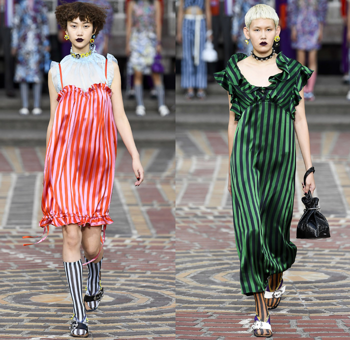 KENZO 2018 Spring Summer Womens Runway Catwalk Looks Paris France Carol Lim Humberto Leon - Future Mayhem Sportswear Soccer Football Jersey Ruffles Frills Flounce Sheer Chiffon Organza Tulle Flowers Floral Botanical Print Graphic Pattern Motif PVC Vinyl Pleather Cinch Pleats Deconstructed Paisley Drawstring Outerwear Trench Coat Jacket Blazer Shirtdress Jerseydress Tankdress One Shoulder Bow Tie Up Ribbon Knot Blouse Knit Sweater Jumper Bustier Crop Top Midriff Bikini Top Shorts Trousers Cropped Pants Earrings Frock Miniskirt Maxi Dress Striped Socks Sandals Choker Dog Collar Bells Sunglasses Handbag Pouch Bucket Hat